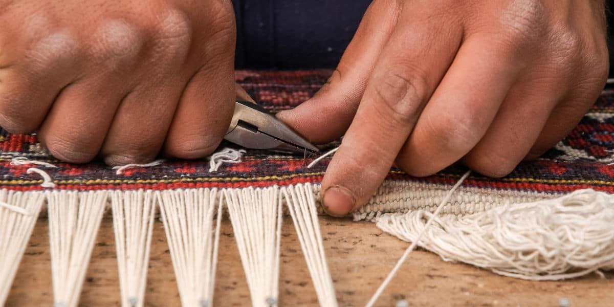 Perzisch tapijt knopen